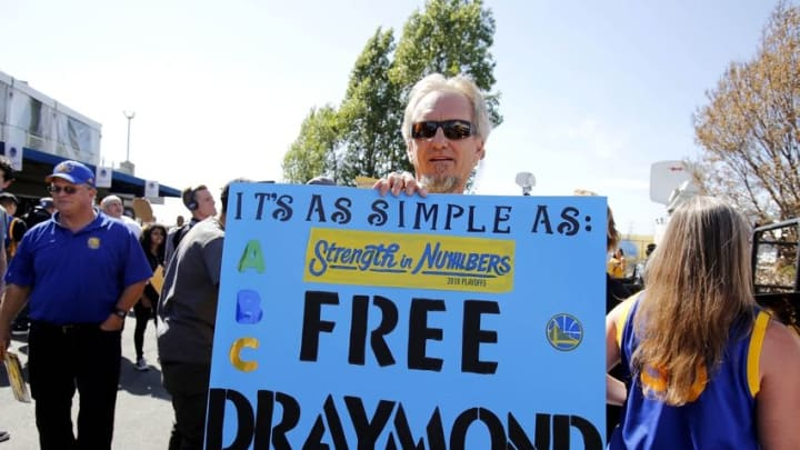 Jun 13, 2016; Oakland, CA, USA; Golden State Warriors fan Doug Anderson holds up a sign in support of Golden State Warriors suspended forward Draymond Green (not pictured) before game five of the NBA Finals against the Cleveland Cavaliers at Oracle Arena. Mandatory Credit: Kelley L Cox-USA TODAY Sports