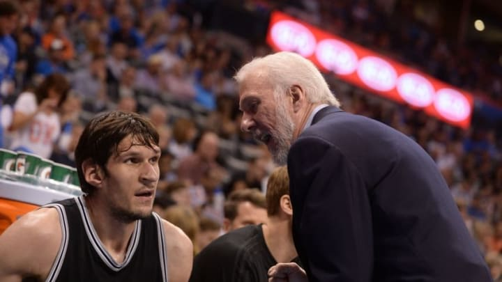 Mar 26, 2016; Oklahoma City, OK, USA; San Antonio Spurs head coach Gregg Popovich speaks to San Antonio Spurs center Boban Marjanovic (40) during action against the Oklahoma City Thunder during the first quarter at Chesapeake Energy Arena. Mandatory Credit: Mark D. Smith-USA TODAY Sports