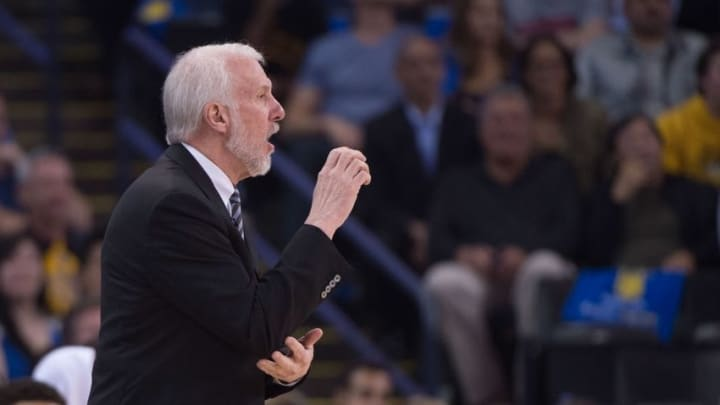 April 7, 2016; Oakland, CA, USA; San Antonio Spurs head coach Gregg Popovich instructs during the first quarter against the Golden State Warriors at Oracle Arena. The Warriors defeated the Spurs 112-101. Mandatory Credit: Kyle Terada-USA TODAY Sports
