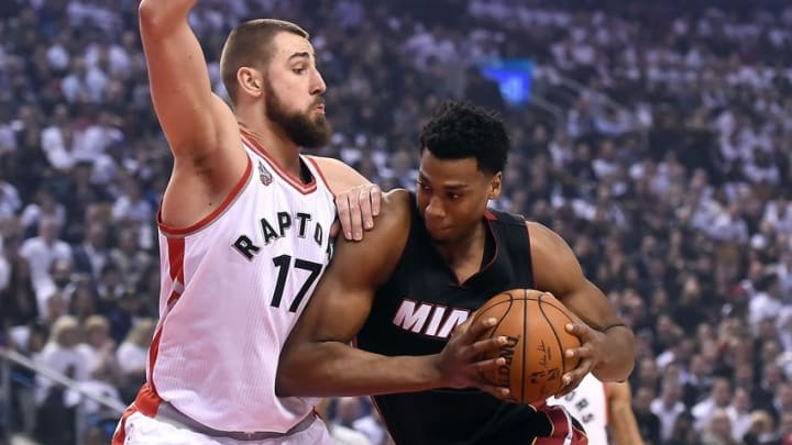 May 5, 2016; Toronto, Ontario, CAN; Miami Heat center Hassan Whiteside (21) bumps into Toronto Raptors center Jonas Valanciunas (17) in game two of the second round of the NBA Playoffs at Air Canada Centre. Mandatory Credit: Dan Hamilton-USA TODAY Sports