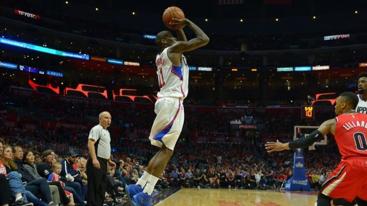Apr 27, 2016; Los Angeles, CA, USA; Los Angeles Clippers guard Jamal Crawford (11) takes a 3 point shot in the second half of game five of the first round of the NBA Playoffs against the Portland Trail Blazers at Staples Center. Trail Blazers won 108-98. Mandatory Credit: Jayne Kamin-Oncea-USA TODAY Sports