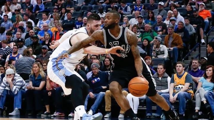 Apr 8, 2016; Denver, CO, USA; Denver Nuggets center Joffrey Lauvergne (77) defends against San Antonio Spurs guard Jonathon Simmons (17) in the second quarter at the Pepsi Center. Mandatory Credit: Isaiah J. Downing-USA TODAY Sports