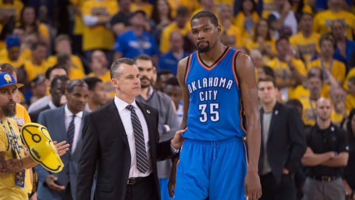 May 30, 2016; Oakland, CA, USA; Oklahoma City Thunder head coach Billy Donovan (left) instructs forward Kevin Durant (35) during the fourth quarter in game seven of the Western conference finals of the NBA Playoffs against the Golden State Warriors at Oracle Arena. The Warriors defeated the Thunder 96-88. Mandatory Credit: Kyle Terada-USA TODAY Sports