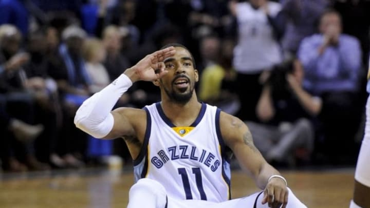 Feb 8, 2016; Memphis, TN, USA; Memphis Grizzlies guard Mike Conley (11) reacts to a play during the first half against the Portland Trail Blazers at FedExForum. Mandatory Credit: Justin Ford-USA TODAY Sports