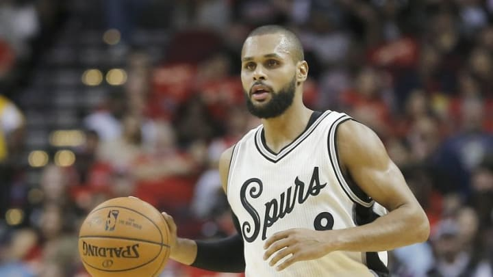 Dec 25, 2015; Houston, TX, USA; San Antonio Spurs guard Patty Mills (8) dribbles against the Houston Rockets in the first half of a NBA basketball game on Christmas at Toyota Center. Mandatory Credit: Thomas B. Shea-USA TODAY Sports