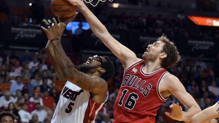 Apr 7, 2016; Miami, FL, USA; Chicago Bulls center Pau Gasol (16) blocks the shot by Miami Heat forward Amar