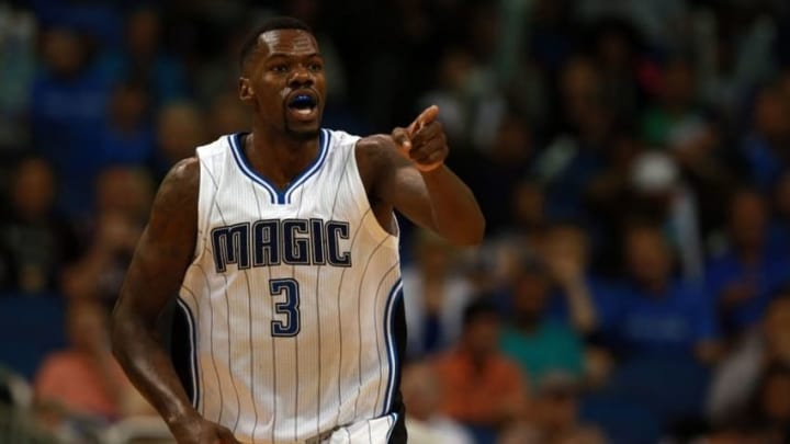 Mar 29, 2016; Orlando, FL, USA; Orlando Magic center Dewayne Dedmon (3) points and celebrates after he made a layup against the Brooklyn Nets during the second half at Amway Center. Orlando Magic defeated the Brooklyn Nets 139-105. Mandatory Credit: Kim Klement-USA TODAY Sports