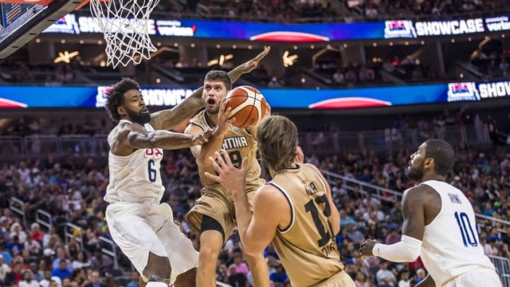 Jul 22, 2016; Las Vegas, NV, USA; Argentina forward Patricio Garino (29) takes the ball to the net while being defended by USA center DeAndre Jordan (6) during a basketball exhibition game at T-Mobile Arena. USA won 111-74. Mandatory Credit: Joshua Dahl-USA TODAY Sports
