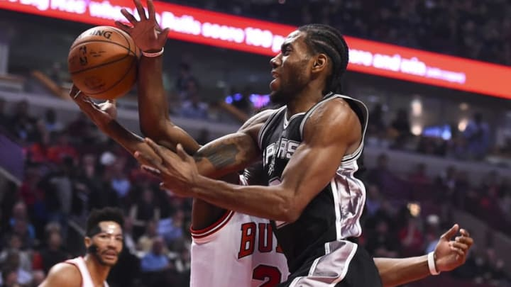 Nov 30, 2015; Chicago, IL, USA; San Antonio Spurs forward Kawhi Leonard (2) shoots the ball against Chicago Bulls guard Jimmy Butler (21) during the first quarter at the United Center. Mandatory Credit: Mike DiNovo-USA TODAY Sports