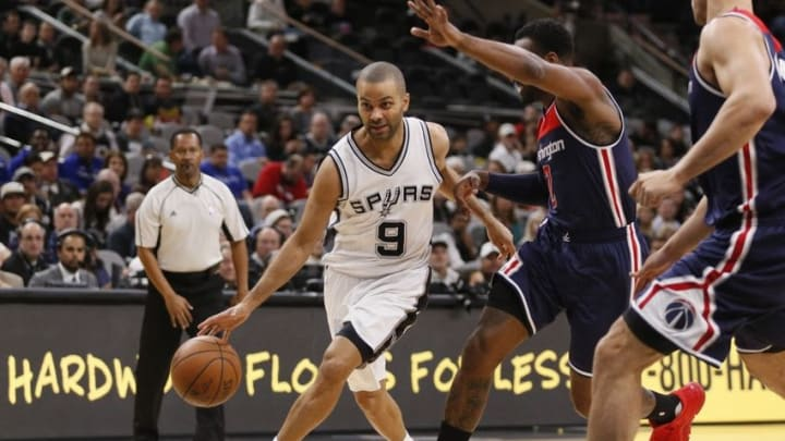 Dec 16, 2015; San Antonio, TX, USA; San Antonio Spurs point guard Tony Parker (9) drives to the basket while guarded by Washington Wizards player John Wall (2) during the first half at AT&T Center. Mandatory Credit: Soobum Im-USA TODAY Sports
