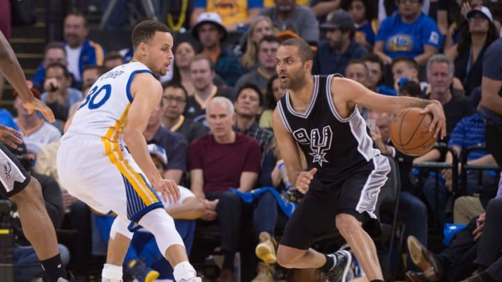 April 7, 2016; Oakland, CA, USA; San Antonio Spurs guard Tony Parker (9) dribbles the basketball against Golden State Warriors guard Stephen Curry (30) during the third quarter at Oracle Arena. The Warriors defeated the Spurs 112-101. Mandatory Credit: Kyle Terada-USA TODAY Sports