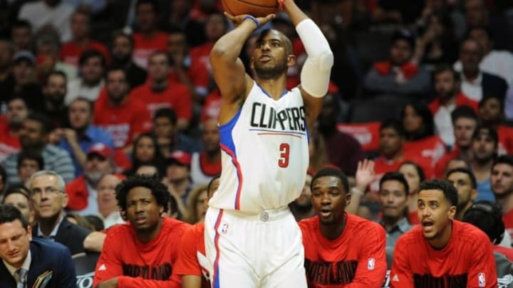 April 20, 2016; Los Angeles, CA, USA; Los Angeles Clippers guard Chris Paul (3) shoots a three point basket against Portland Trail Blazers during the second half at Staples Center. Mandatory Credit: Gary A. Vasquez-USA TODAY Sports