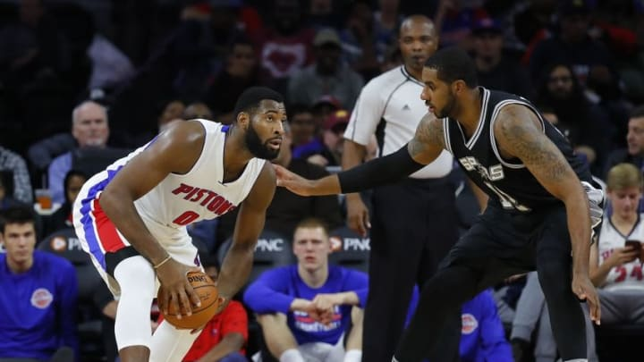 Oct 10, 2016; Auburn Hills, MI, USA; Detroit Pistons center Andre Drummond (0) looks to pass the ball as San Antonio Spurs forward LaMarcus Aldridge (12) defends during the second quarter of the game at The Palace of Auburn Hills. The Spurs won 86-81. Mandatory Credit: Leon Halip-USA TODAY Sports