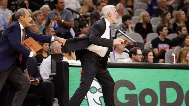 Nov 5, 2016; San Antonio, TX, USA; San Antonio Spurs head coach Gregg Popovich (right) is restrained by assistant coach Ettore Messina during the first half against the LA Clippers at AT&T Center. Mandatory Credit: Soobum Im-USA TODAY Sports