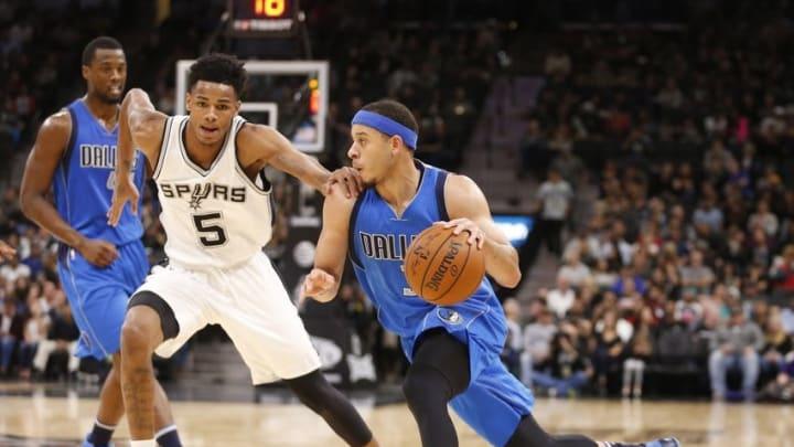 Nov 21, 2016; San Antonio, TX, USA; Dallas Mavericks shooting guard Seth Curry (30) dribbles the ball as San Antonio Spurs point guard Dejounte Murray (5) defends during the second half at AT&T Center. Mandatory Credit: Soobum Im-USA TODAY Sports