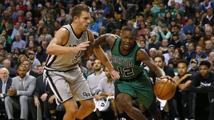 Nov 25, 2016; Boston, MA, USA; Boston Celtics guard Terry Rozier (12) drives on San Antonio Spurs forward David Lee (10) during the first half at TD Garden. Mandatory Credit: Winslow Townson-USA TODAY Sports