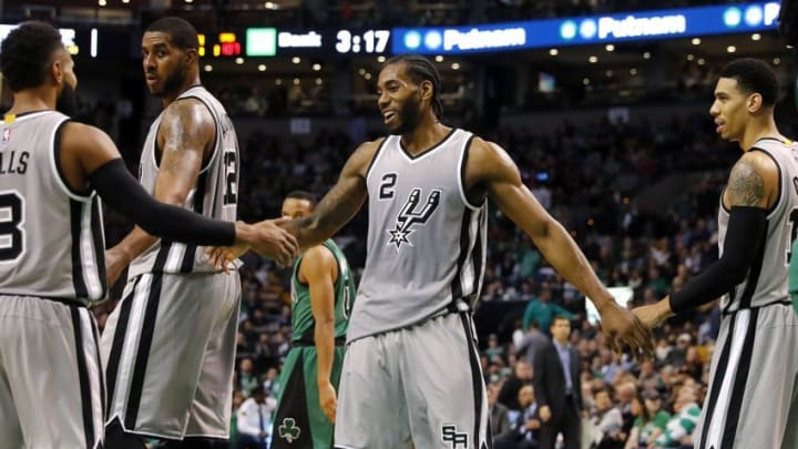 Nov 25, 2016; Boston, MA, USA; San Antonio Spurs forward Kawhi Leonard (2) is congratulated after a basket by guard Patty Mills (8) and guard Danny Green (14) during the second half of the San Antonio Spurs 109-103 win over the Boston Celtics at TD Garden. Mandatory Credit: Winslow Townson-USA TODAY Sports