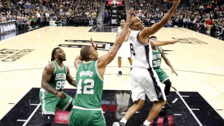 Dec 14, 2016; San Antonio, TX, USA; San Antonio Spurs point guard Tony Parker (9) shoots the ball past Boston Celtics center Al Horford (42) during the second half at AT&T Center. The Spurs won 108-101. Mandatory Credit: Soobum Im-USA TODAY Sports