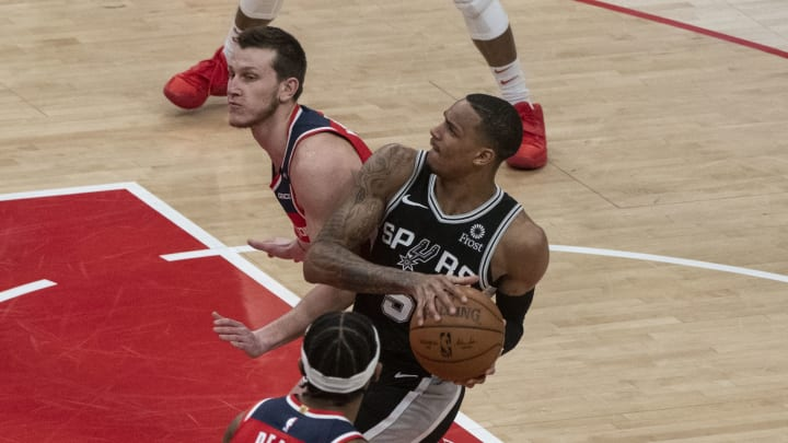 Apr 26, 2021; Washington, District of Columbia, USA; San Antonio Spurs guard Dejounte Murray (5) looks to shoots as Washington Wizards guard Garrison