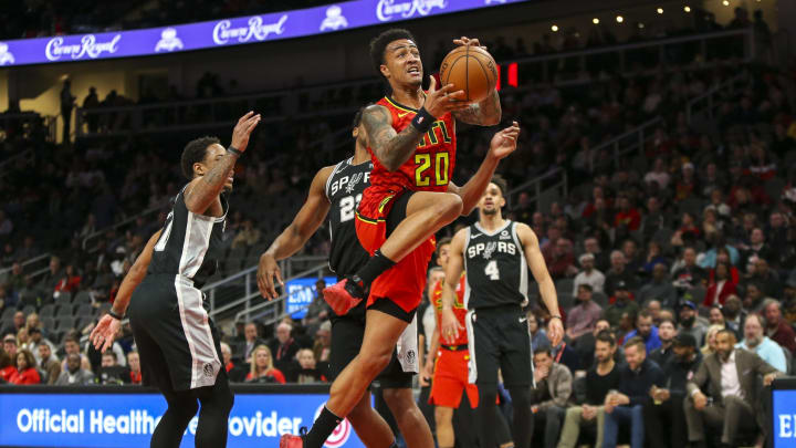 Mar 6, 2019; Atlanta, GA, USA; Atlanta Hawks forward John Collins (20) shoots against the San Antonio Spurs in the first quarter at State Farm Arena.