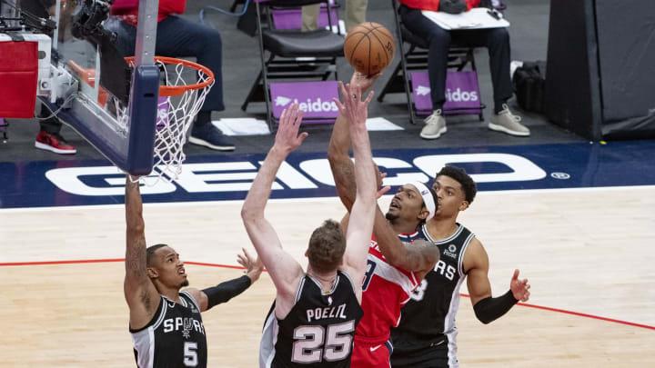 Apr 26, 2021; Washington, District of Columbia, USA; Washington Wizards guard Bradley Beal (3) shoots one rSan Antonio Spurs defenders during over tim