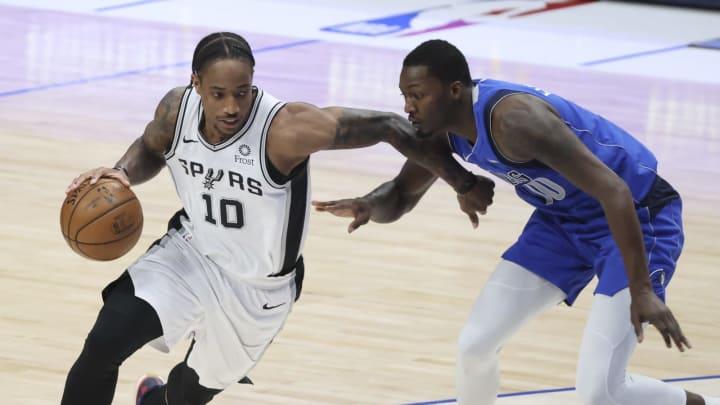 Apr 11, 2021; Dallas, Texas, USA; San Antonio Spurs forward DeMar DeRozan (10) drives to the basket as Dallas Mavericks forward Dorian Finney-Smith (1