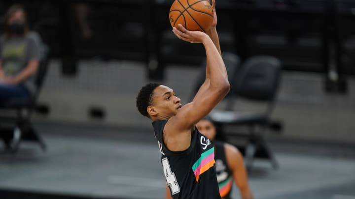 Apr 5, 2021; San Antonio, Texas, USA; San Antonio Spurs guard Devin Vassell (24) shoots in the first half against the Cleveland Cavaliers at the AT&T