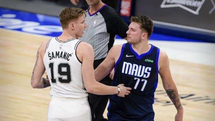 Mar 10, 2021; Dallas, Texas, USA; San Antonio Spurs forward Luka Samanic (19) talks with Dallas Mavericks guard Luka Doncic (77) after the game at the
