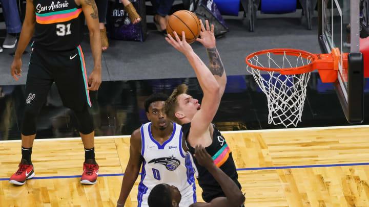 Apr 12, 2021; Orlando, Florida, USA; San Antonio Spurs forward Luka Samanic (19) drives to the basket through Orlando Magic guard Karim Mane (4) and f