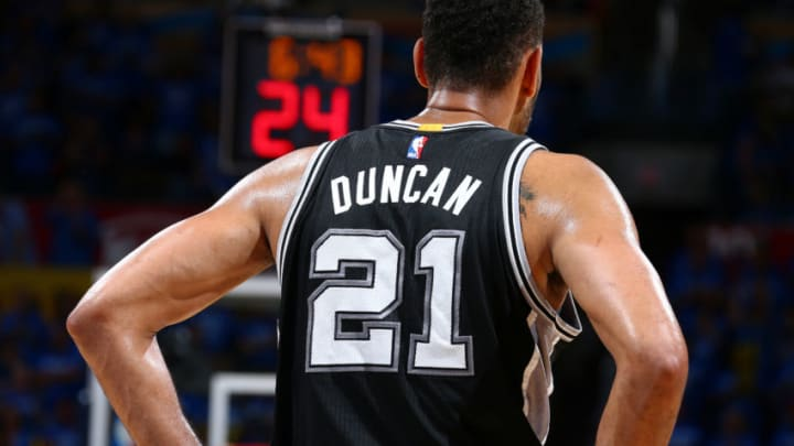 OKLAHOMA CITY, OK- MAY 12: Tim Duncan #21 of the San Antonio Spurs looks on during the game against the Oklahoma City Thunder in Game Six of the Western Conference Semifinals during the 2016 NBA Playoffs on May 12, 2016 at Chesapeake Energy Arena in Oklahoma City, Oklahoma. NOTE TO USER: User expressly acknowledges and agrees that, by downloading and or using this photograph, User is consenting to the terms and conditions of the Getty Images License Agreement. Mandatory Copyright Notice: Copyright 2016 NBAE (Photo by Nathaniel S. Butler/NBAE via Getty Images)