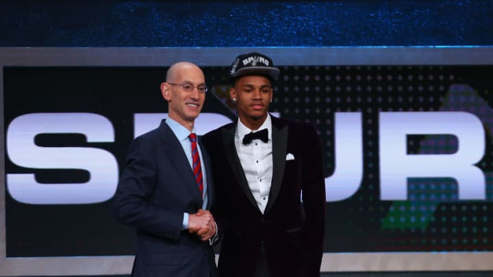 NEW YORK, NY – JUNE 23: Dejounte Murray shakes hands with Commissioner Adam Silver after being drafted 29th overall by the San Antonio Spurs in the first round of the 2016 NBA Draft at the Barclays Center on June 23, 2016 in the Brooklyn borough of New York City. NOTE TO USER: User expressly acknowledges and agrees that, by downloading and or using this photograph, User is consenting to the terms and conditions of the Getty Images License Agreement. (Photo by Mike Stobe/Getty Images)