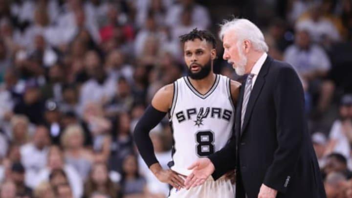 SAN ANTONIO, TX – MAY 20: Head coach Gregg Popovich of the San Antonio Spurs talks with Patty Mills