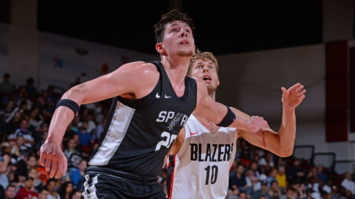 LAS VEGAS, NV - JULY 10: Drew Eubanks #25 of the San Antonio Spurs boxes out against Jake Layman #10 of the Portland Trail Blazers during the 2018 Las Vegas Summer League on July 10, 2018 at the Cox Pavilion in Las Vegas, Nevada. NOTE TO USER: User expressly acknowledges and agrees that, by downloading and/or using this photograph, user is consenting to the terms and conditions of the Getty Images License Agreement. Mandatory Copyright Notice: Copyright 2018 NBAE (Photo by Bart Young/NBAE via Getty Images)