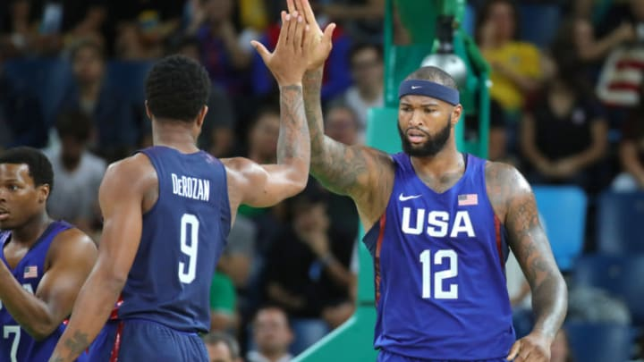 DeMarcus Cousins of the USA gives a high five to teammate Demar DeRozan (L) during the Basketball Men's Gold Medal Game between Serbia and the USA during the Rio 2016 Olympic Games at the Carioca Arena 1 in the Olympic Park in Rio de Janeiro, Brazil, 21 August 2016. Photo: Friso Gentsch/dpa | usage worldwide (Photo by Friso Gentsch/picture alliance via Getty Images)