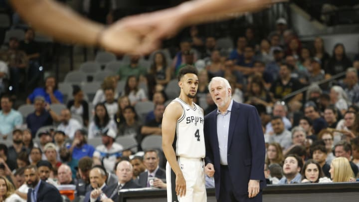 SAN ANTONIO,TX – SEPTEMBER 30 : Head coach Gregg Popovich of San Antonio Spurs talks with Derrick White #4 of the San Antonio Spurs in a preseason game against the Miami Heat in 2018. (Photo by Ronald Cortes/Getty Images)