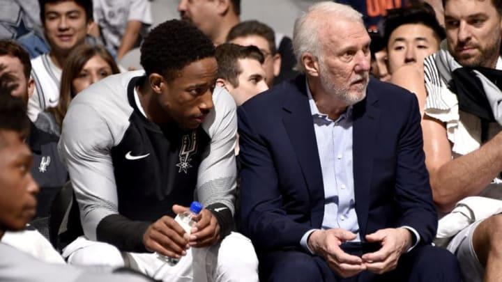 San Antonio Spurs head coach Gregg Popovich and shooting guard DeMar DeRozan (Photo by Bill Baptist/NBAE via Getty Images)