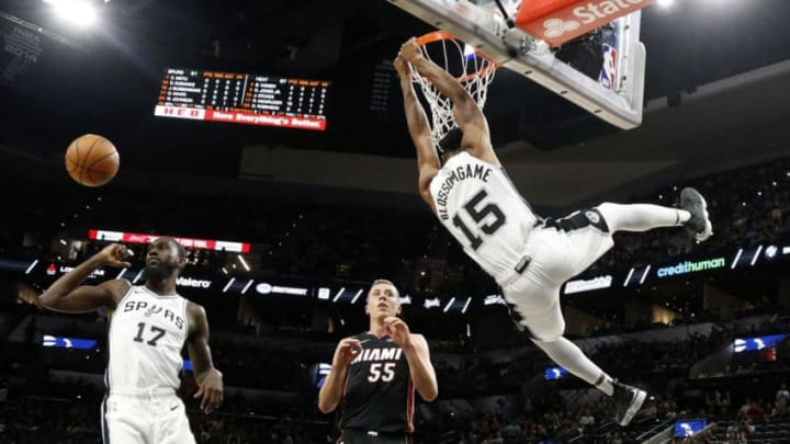 SAN ANTONIO,TX - SEPTEMBER 30 : Jaron Blossomgame #15 of the San Antonio Spurs dunks in front of Duncan Robinson #55 of the Miami Heat in a Preseason game at AT&T Center on September 30 , 2018 in San Antonio, Texas. NOTE TO USER: User expressly acknowledges and agrees that , by downloading and or using this photograph, User is consenting to the terms and conditions of the Getty Images License Agreement. (Photo by Ronald Cortes/Getty Images)