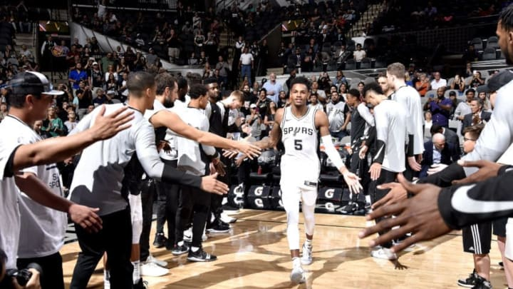 SAN ANTONIO, TX - SEPTEMBER 30: Dejounte Murray #5 of the San Antonio Spurs gets introduced before the game against the Miami Heat on September 30, 2018 at the AT&T Center in San Antonio, Texas. NOTE TO USER: User expressly acknowledges and agrees that, by downloading and/or using this Photograph, user is consenting to the terms and conditions of the Getty Images License Agreement. Mandatory Copyright Notice: Copyright 2018 NBAE (Photo by Bill Baptist/NBAE via Getty Images)