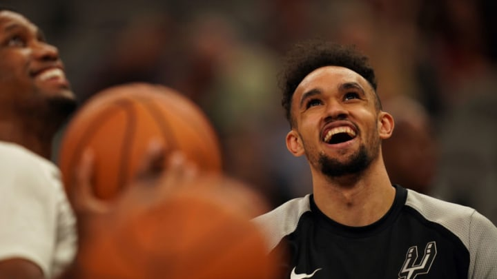 SAN ANTONIO, TX - OCTOBER 5: Derrick White #4 of the San Antonio Spurs smiles before a preseason game against the Detroit Pistons at AT&T Center in San Antonio, Texas on October 5, 2018. NOTE TO USER: User expressly acknowledges and agrees that, by downloading and/or using this photograph, user is consenting to the terms and conditions of the Getty Images License Agreement. Mandatory Copyright Notice: Copyright 2018 NBAE (Photo by Darren Carroll/NBAE via Getty Images)