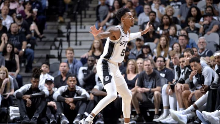 SAN ANTONIO, TX - OCTOBER 5: Dejounte Murray #5 of the San Antonio Spurs plays defense against the Detroit Pistons during a pre-season game on October 5, 2018 at the AT&T Center in San Antonio, Texas. NOTE TO USER: User expressly acknowledges and agrees that, by downloading and or using this photograph, user is consenting to the terms and conditions of the Getty Images License Agreement. Mandatory Copyright Notice: Copyright 2018 NBAE (Photos by Mark Sobhani/NBAE via Getty Images)