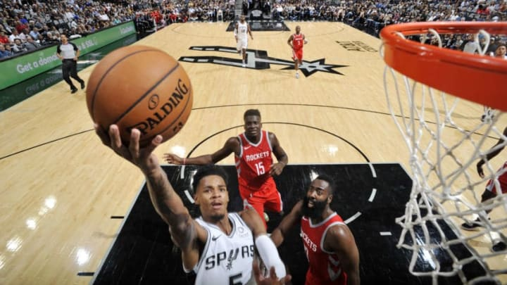 SAN ANTONIO, TX - OCTOBER 7: Dejounte Murray #5 of the San Antonio Spurs shoots the ball against the Houston Rockets during a pre-season game on October 7, 2018 at the AT&T Center in San Antonio, Texas. NOTE TO USER: User expressly acknowledges and agrees that, by downloading and or using this photograph, user is consenting to the terms and conditions of the Getty Images License Agreement. Mandatory Copyright Notice: Copyright 2018 NBAE (Photos by Mark Sobhani/NBAE via Getty Images)