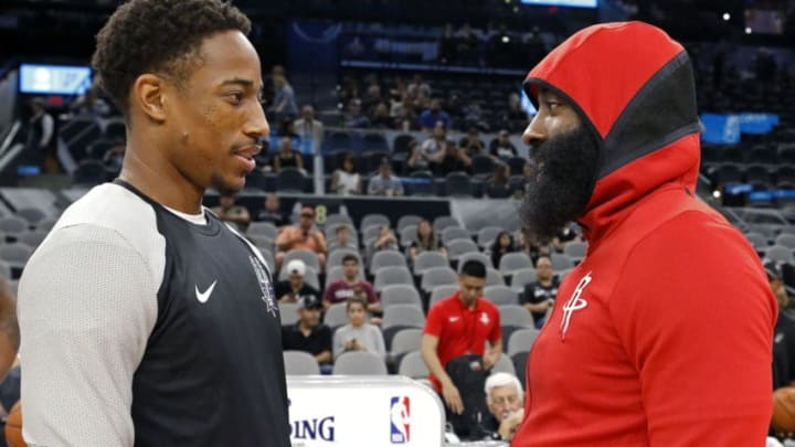 SAN ANTONIO, TX - OCTOBER 7: DeMar DeRozan #10 of the San Antonio Spurs talks with James Harden #13 of the Houston Rockets before a preseason game on October 7, 2018 at the AT&T Center in San Antonio, Texas. NOTE TO USER: User expressly acknowledges and agrees that, by downloading and or using this photograph, User is consenting to the terms and conditions of the Getty Images License Agreement. (Photo by Edward A. Ornelas/Getty Images)