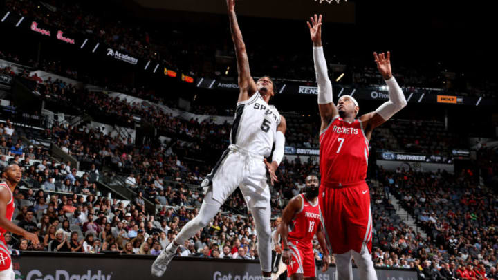 SAN ANTONIO, TX - OCTOBER 7: Dejounte Murray #5 of the San Antonio Spurs shoots the ball against the Houston Rockets during a pre-season game on October 7, 2018 at AT&T Center, in San Antonio, Texas. NOTE TO USER: User expressly acknowledges and agrees that, by downloading and/or using this Photograph, user is consenting to the terms and conditions of the Getty Images License Agreement. Mandatory Copyright Notice: Copyright 2018 NBAE (Photo by Nathaniel S. Butler/NBAE via Getty Images)