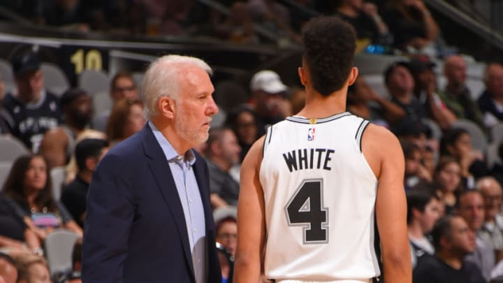 SAN ANTONIO, TX - SEPTEMBER 30: Head Coach Gregg Popovich and Derrick White #4 of the San Antonio Spurs look on during a pre-season game against the Miami Heat on September 30, 2018 at the AT&T Center in San Antonio, Texas. NOTE TO USER: User expressly acknowledges and agrees that, by downloading and/or using this Photograph, user is consenting to the terms and conditions of the Getty Images License Agreement. Mandatory Copyright Notice: Copyright 2018 NBAE (Photo by Bill Baptist/NBAE via Getty Images)