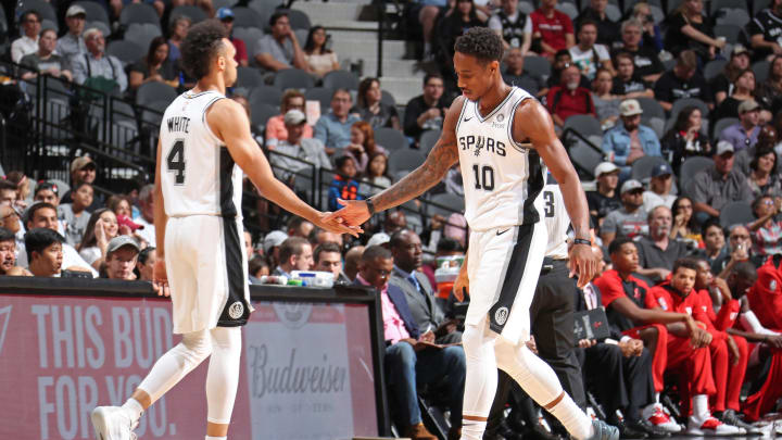 SAN ANTONIO, TX – OCTOBER 7: Derrick White #4 and DeMar DeRozan #10 of the San Antonio Spurs exchange high fives against the Houston Rockets on October 7, 2018 at AT&T Center, in San Antonio, Texas. (Photo by Nathaniel S. Butler/NBAE via Getty Images)