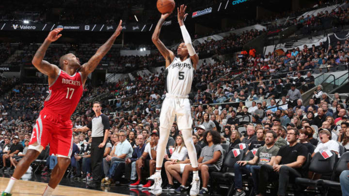 SAN ANTONIO, TX - OCTOBER 7: Dejounte Murray #5 of the San Antonio Spurs shoots the ball against the Houston Rockets (Photo by Nathaniel S. Butler/NBAE via Getty Images)