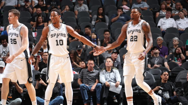 SAN ANTONIO, TX – OCTOBER 7: DeMar DeRozan #10 and Rudy Gay #22 of the San Antonio Spurs exchange high fives against Houston Rockets on October 7, 2018 at AT&T Center, in San Antonio, Texas. NOTE TO USER: User expressly acknowledges and agrees that, by downloading and/or using this Photograph, user is consenting to the terms and conditions of the Getty Images License Agreement. Mandatory Copyright Notice: Copyright 2018 NBAE (Photo by Nathaniel S. Butler/NBAE via Getty Images)