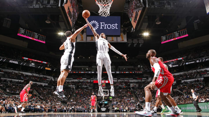 SAN ANTONIO, TX – OCTOBER 7: Dejounte Murray #5 of the San Antonio Spurs shoots the ball against the Houston Rockets on October 7, 2018 at AT&T Center, in San Antonio, Texas.