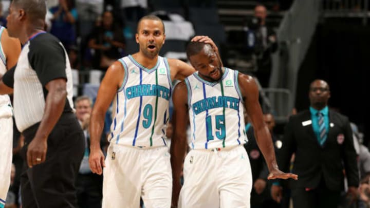 Former San Antonio Spurs point guard Tony Parker and teammate Kemba Walker celebrate for the Hornets (Photo by Kent Smith/NBAE via Getty Images)