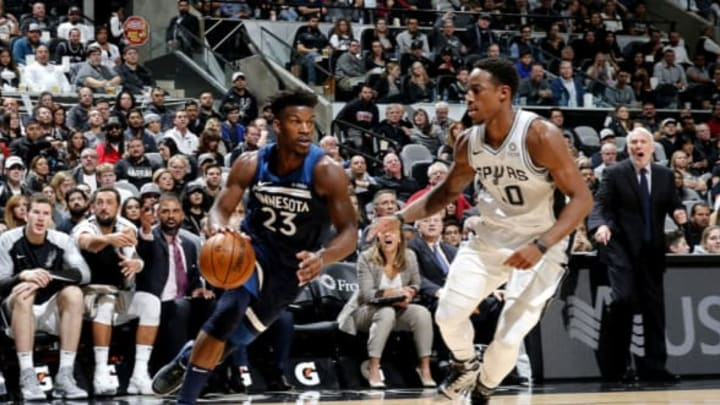 DeMar DeRozan of the San Antonio Spurs guards Jimmy Butler of the Minnesota Timberwolves (Photos by Chris Covatta/NBAE via Getty Images)